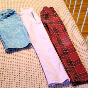 Two girls pant and one short.